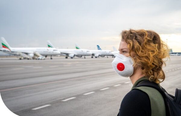 woman-with-facemask-at-airport